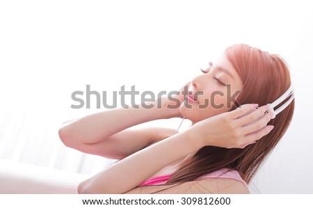 Young beautiful woman enjoying the music at home, asian beauty - stock photo