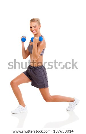 young beautiful woman exercises with dumbbells isolated on white