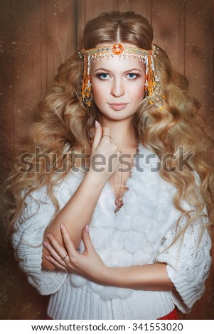 Young beautiful woman fortuneteller holds the ring in his hand. Divination - stock photo