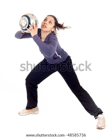 young beautiful woman goalkeeper catching ball isolated on white