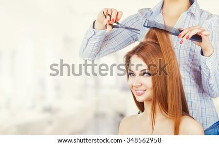 Young beautiful woman hair cut in a beauty salon - stock photo
