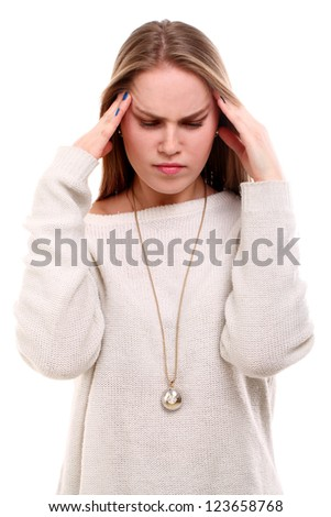 Young beautiful woman have a headache isolated on white background - stock photo