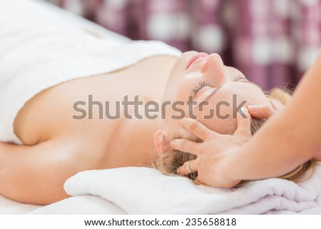 Young beautiful woman having spa massage of her head - stock photo