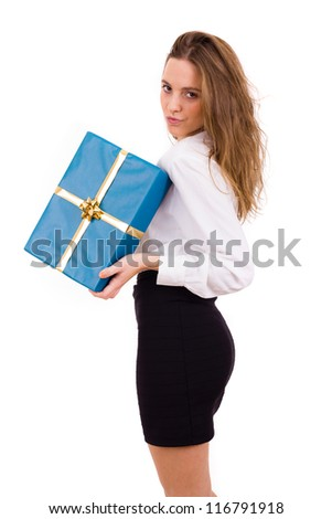 Young beautiful woman holding a gift on white background