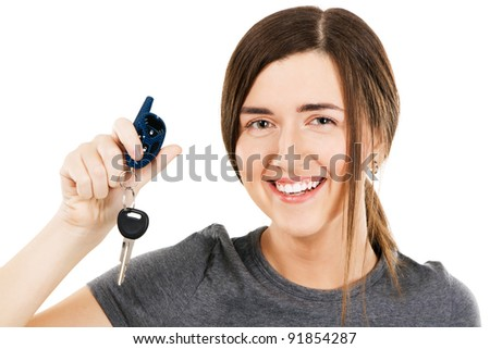 Young beautiful woman holding car keys on her finger