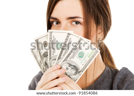 Young beautiful woman holding dollar bills, isolated on white background
