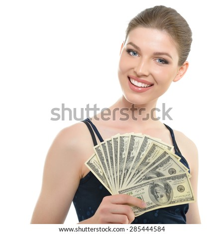 Young beautiful woman holding money and happy smiling - stock photo