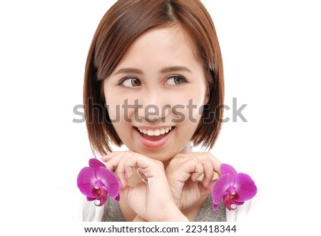 young beautiful woman holding pink flower - stock photo