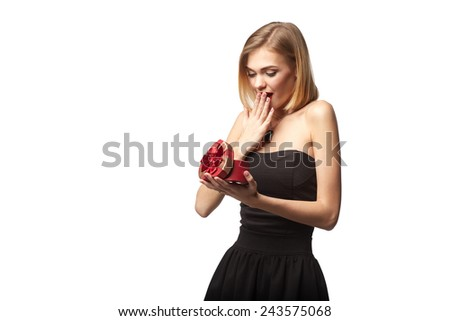 Young beautiful woman holding small red box. Studio portrait isolated over white background - stock photo