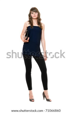 Young beautiful woman in a black leggings. Isolated on white