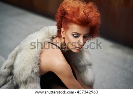 Young beautiful woman in a fur coat - stock photo