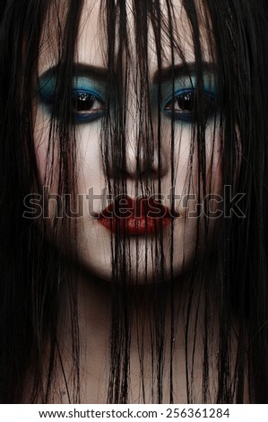 Young beautiful woman in a vampire look - stock photo