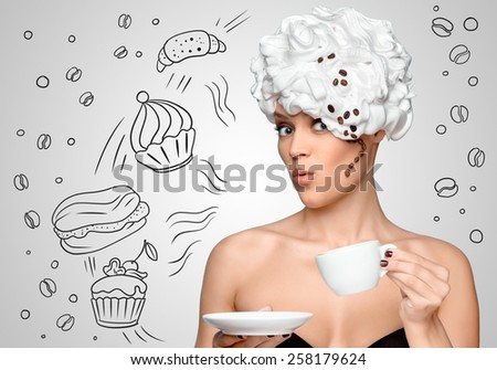 Young beautiful woman in a whipped cream topping on her hair, with a curl made of coffee beans, drinking coffee and holding a coffee cup on sketchy background of bakery sweets. - stock photo