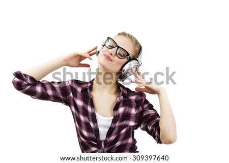 Young beautiful woman in bright outfit enjoying the music - stock photo