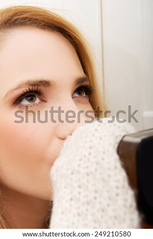 Young beautiful woman in depression, drinking alcohol. - stock photo