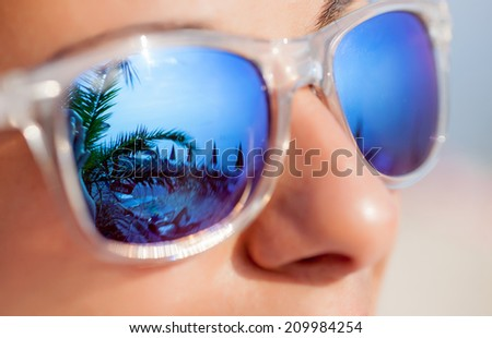 young beautiful woman in glasses outdoors - stock photo