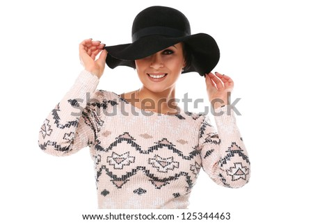 Young beautiful woman in hat and dress isolated over white background