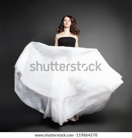 Young beautiful woman in long dress - stock photo