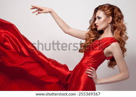 Young beautiful woman in red dress.