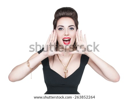 Young beautiful woman in retro pin up style shouting through megaphone shaped hands  - stock photo
