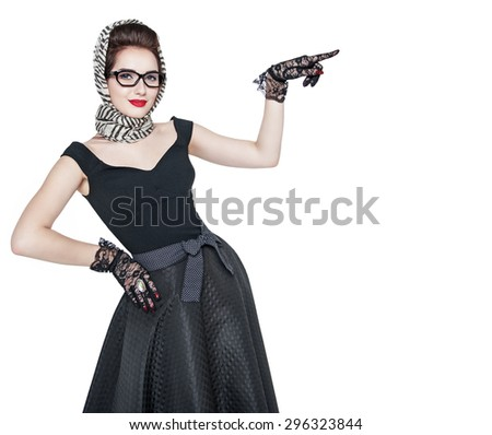 Young beautiful woman in retro pin up style showing on something by finger isolated  - stock photo