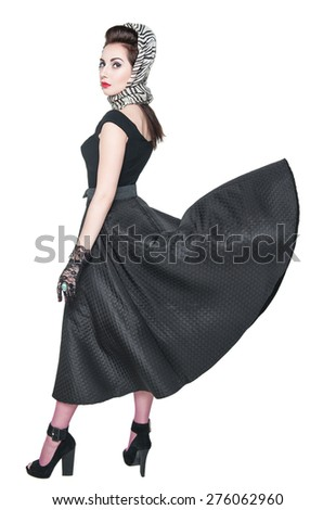 Young beautiful woman in retro pin-up style with fluttering dress isolated over white - stock photo