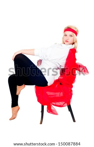 Young beautiful woman in sportswear with chair. Isolated on white - stock photo