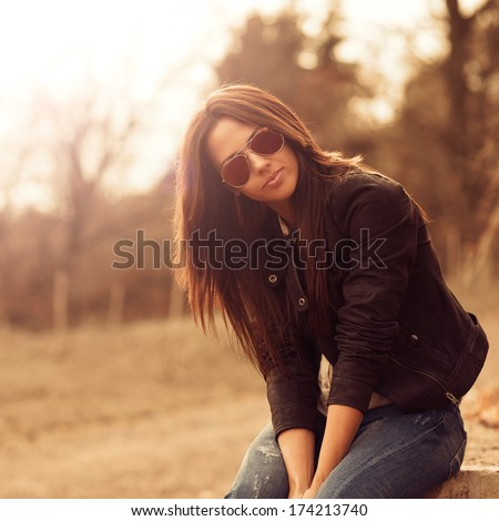 Young beautiful woman in sunglasses at sunny day  - stock photo