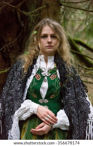 Young beautiful woman in the forest - stock photo