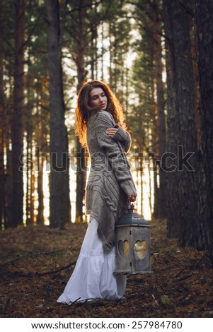 Young beautiful woman in the forest with magic lantern - stock photo