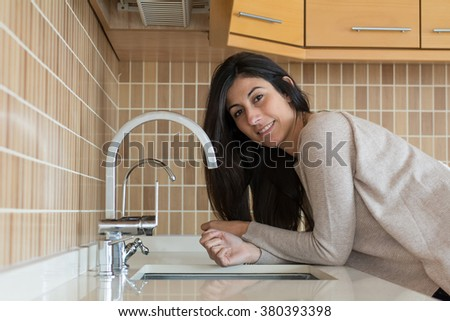 Young beautiful woman in the kitchen