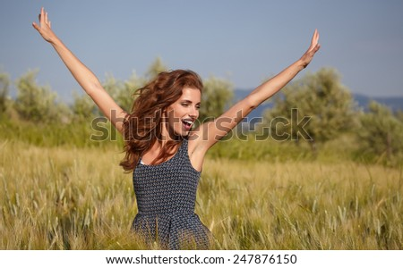 young beautiful woman  in the Toscana field  - stock photo