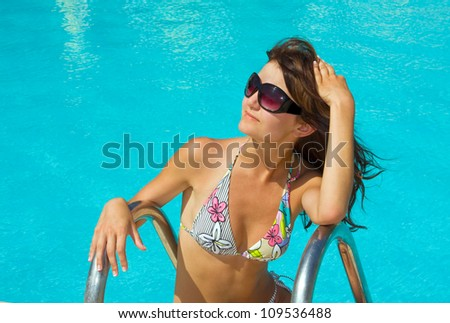 Young beautiful woman in water of pool - stock photo