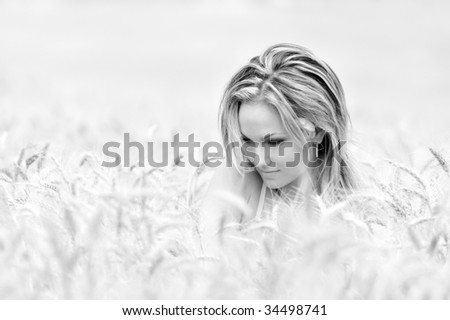young beautiful woman in wheat field