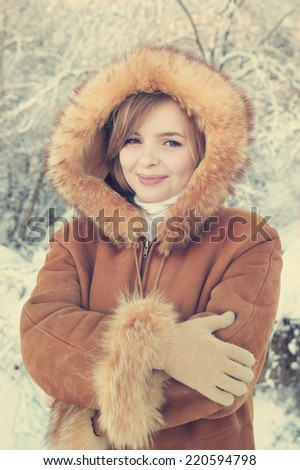 Young beautiful woman in winter forest