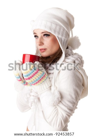 Young beautiful woman in winter warm clothes with red cup on a white background. - stock photo
