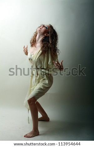 Young beautiful woman in witch look scaring everybody - stock photo