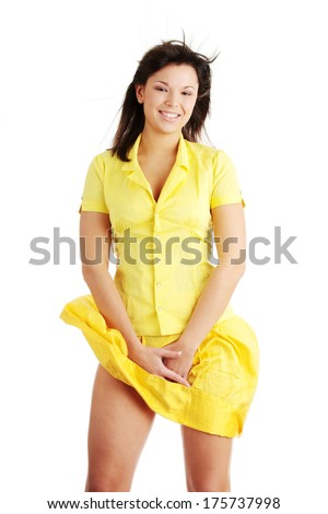Young beautiful woman in yellow summer dress and yellow shirt, isolated on white background - stock photo