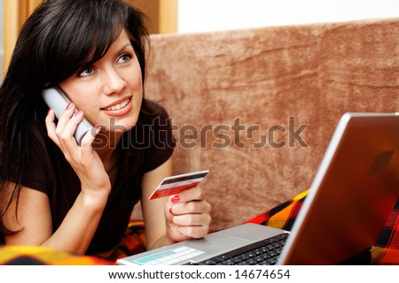 young beautiful woman is calling on the phone