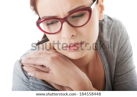 Young beautiful woman is having arm ache.  Isolated on white. - stock photo