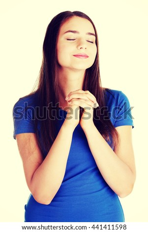 Young beautiful woman is praying. - stock photo