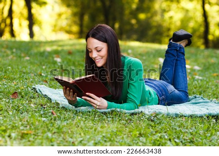 Young beautiful woman is reading a book and enjoy in her free time,Leisure time - stock photo