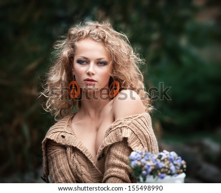 young beautiful woman is resting in the garden