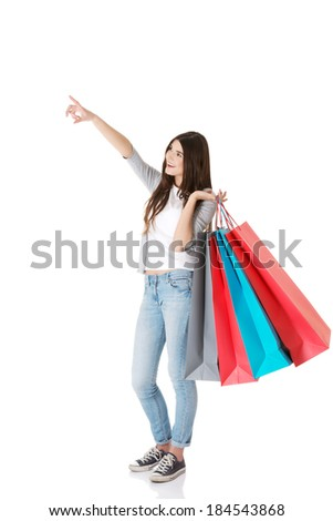 Young beautiful woman is shopping. Isolated on white. - stock photo