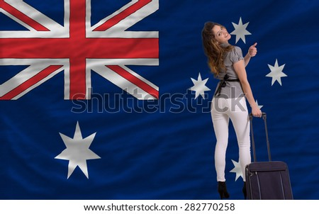 young beautiful woman is traveling to australia - stock photo