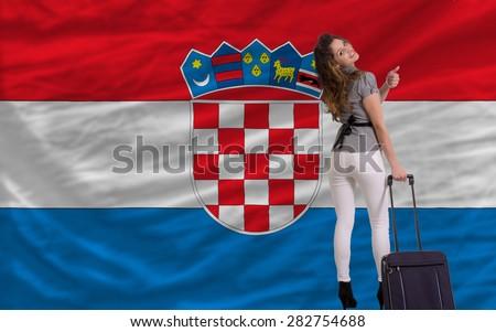 young beautiful woman is traveling to croatia - stock photo