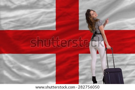 young beautiful woman is traveling to england - stock photo