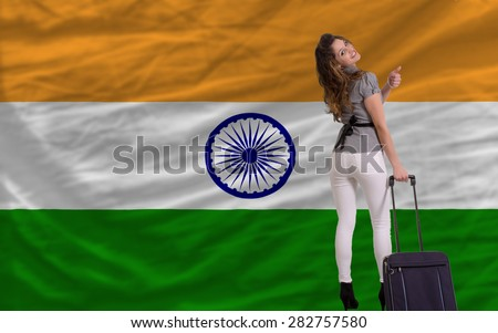 young beautiful woman is traveling to india - stock photo
