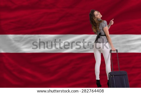 young beautiful woman is traveling to latvia - stock photo
