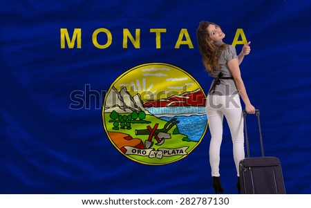 young beautiful woman is traveling to montana - stock photo